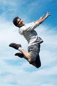 Happy guy jumping — Stock Photo