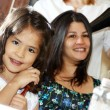 Stock Photo: The Latin small beauty with mother in a hairdressing salon