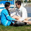 Young couple having a rest in harbour — Stock Photo