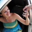 The happy woman during car purchase - Stock Photo