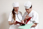 Group of doctors in working conditions — Stock Photo