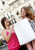 Beautiful teenagers with a shopping bag — Stock Photo