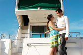 Young married couple having a rest on the yacht — Stock Photo
