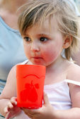 The little girl with a water glass — Stock Photo