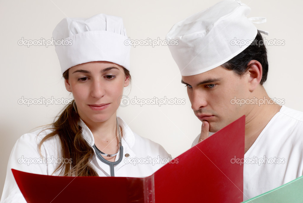 Portrait two doctors in working conditions  Stock Photo #6404571
