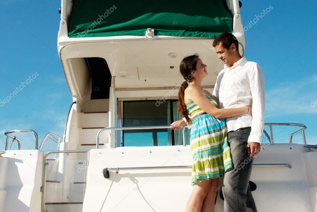 Young married couple having a rest on the yacht  Stock Photo #6405224