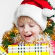 Small Santa Klaus with gifts in hands — Stock Photo