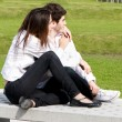 Young love in park on a bench - Stock Photo