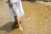 Female feet in river water outdoor — Stock Photo