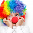 The cheerful clown on a light background — Stock Photo #6670090