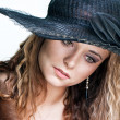 Young woman in a hat portrait — Stock Photo