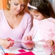 Mother and the daughter сut figures from a colour paper — Stock Photo