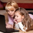 图库照片: Picture of happy mother and child with laptop computer