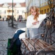 Young woman sitting on a bench — Stock Photo