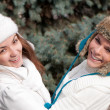 Two cheerful girls twins, in the park - Foto Stock