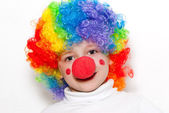 The cheerful clown on a light background — Stock Photo