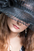 Young woman in a hat — Stock Photo