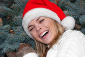 Portrait beauty girl in santa red cap — Stock Photo