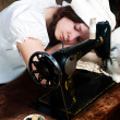 The sleeping young seamstress after wearisome work — Stock Photo