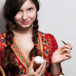 Portrait of a young girl who is painting an egg for easter — Stock Photo