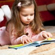 Sweet  little girl reading book — Stock Photo