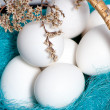 Basket full of easter eggs with spring twigs - 