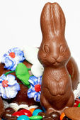 Chocolate easter rabbit with sweets — Stock Photo