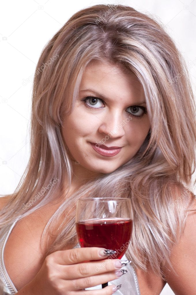 The young girl with a glass of red wine and with manicure on a white background — Stock Photo #5484552