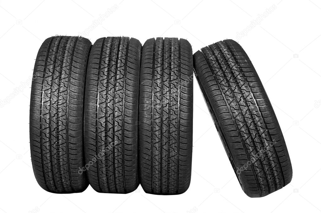 Four all-weather tyres on a white background with a protector — Stock Photo #5772183