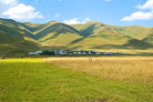 Blue sky and green hills — Stock Photo