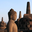 Stock Photo: Statue of Buddha in Borobudur temple