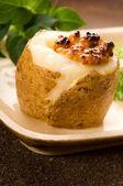Baked potato with sour cream, grain Dijon mustard and herbs — Stock Photo