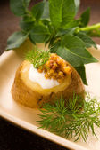 Baked potato with sour cream, grain Dijon mustard and herbs — Stock Photo
