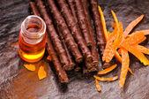Chocolate sticks with orange — Stock Photo