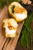 Baked potato with sour cream, grain Dijon mustard and herbs — Stockfoto
