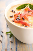Fresh melon soup with parma ham and lavender flower — Stock Photo