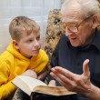 Grandfather Reading To His Grandson — Stock Photo