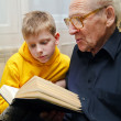 Grandfather Reading — Stock Photo