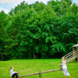 Bride, Groom And Seesaw — Stock Photo