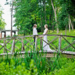 newlyweds on a bridge — Stock Photo