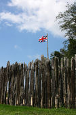 Jamestown colony fence with british flag — Stock Photo