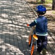 Stock Photo: Child on Bike in Helmet