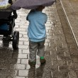 Child with Umbrella in the rain — Stock Photo