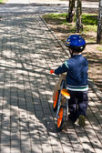 Child on Bike in a Helmet — Stock Photo