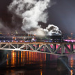 Foto de Stock  : Warsaw Bridge Lighting Show with trains