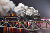 Warsaw Bridge Lighting Show with trains — Stock Photo