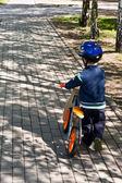 Child on bike — Stock Photo
