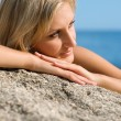Thoughtful girl on the beach — Stock Photo