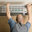 Adjuster air conditioning system sets a new air conditioner — Stock Photo