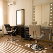 Modern salon make-up artist and hairdresser - Stock Photo